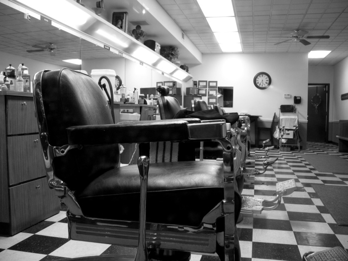 Old school barber shop with a checkerboard floor in black and white