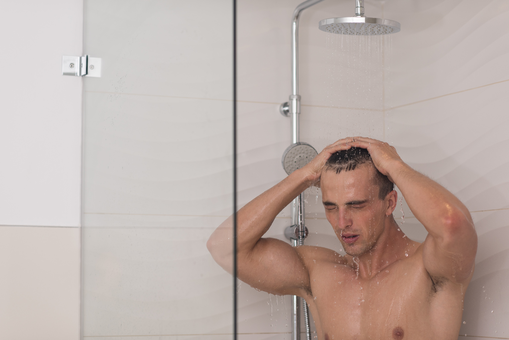 Sexy man tattoo on shower stock photo